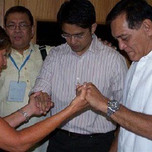 Cyndi Praying with the Mayor